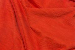 Fond rouge lumineux de tissu Images stock
