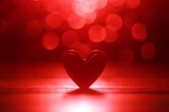 Fond rouge rougeoyant de coeurs Photographie stock