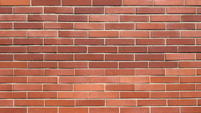 Fond rouge sans couture de mur de briques Photographie stock