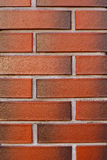 Fond rouge texturisé de mur de briques propre et nouveau Image libre de droits