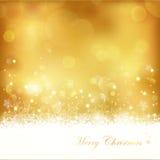 Fond rougeoyant d'or de Noël Photographie stock