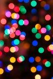 Fond rougeoyant de lumières de Noël Photo stock