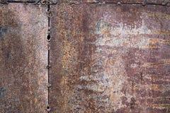 Fond rouillé usé de texture en métal de brun foncé Photo libre de droits