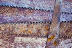Fond rustique de fourche de scie vieux Images stock