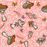 Fond sans couture avec des champignons, des aiguilles et des mites Agari de mouche d'amanite images stock