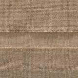 Fond sans couture de bord de tissu de toile de jute, cadre de tissu de sac à bande Photo stock