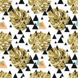 Fond sans couture de palmettes d'or tropicales Photos stock