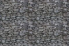 Fond sans joint : mur en pierre Image libre de droits