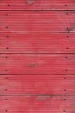 Fond se composant des planches et des clous portés rouges Photographie stock libre de droits