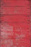 Fond se composant des planches et des clous portés rouges Images libres de droits