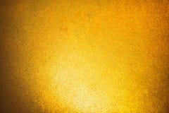 Fond simple d'abrégé sur lumière de gradient d'or pour la conception de contexte de produit ou de textes Photos stock