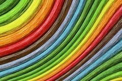 Fond sinueux de bâtons d'arc-en-ciel abstrait Photographie stock libre de droits