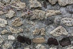 Fond tacheté de mur de pierres photographie stock