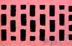 Fond, texture Brique rugueuse rouge avec des trous photos stock