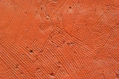 Fond, texture : mur rudement plâtré d'orange Photographie stock