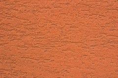 Fond texturisé de couleur orange lumineux de stuc Photo stock