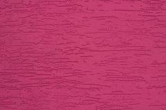 Fond texturisé de stuc coloré par rose lumineux Photos stock