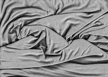 Fond texturisé froissé de tissu noir et blanc Photo stock