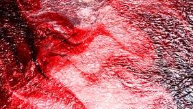 Fond texturisé métallique ombragé rouge de résumé avec des effets de la lumière wallpaper photo stock