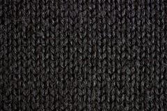 Fond texturisé tricoté par noir Photo libre de droits