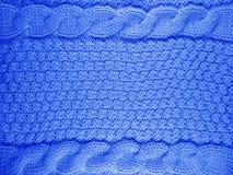 Fond tricoté de laine - bleu-foncé Images stock
