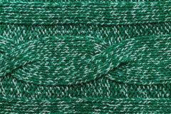 Fond tricoté de vert de débardeur avec un modèle en relief. Haut reso Images stock