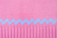 Fond tricoté. Macro rose de texture de pullover de laine Image stock