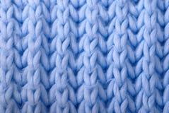 Fond tricoté par laines bleues Photographie stock