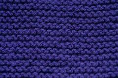 Fond tricoté par pourpre Photos libres de droits