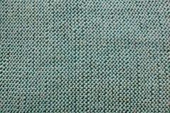 Fond tricoté texturisé vert Photos libres de droits