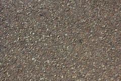 Fond urbain de surface de route goudronnée, texture approximative de bitume Photos libres de droits