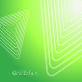 Fond vert abstrait avec les triangles blanches Image stock