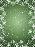 Fond vert avec des flocons de neige Image libre de droits