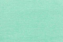 Fond vert clair d'un matériel de textile avec le modèle en osier, plan rapproché photographie stock