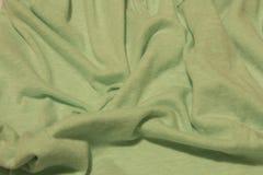 Fond vert clair de tissu Photographie stock libre de droits