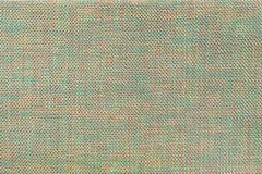 Fond vert clair et rouge de textile avec le modèle d'échecs, plan rapproché Structure du macro de tissu Images stock