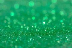 Fond vert d'abrégé sur scintillement avec les lumières defocused de bokeh image libre de droits