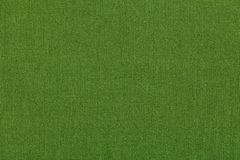 Fond vert d'un matériel de textile avec le modèle, plan rapproché Structure du tissu avec la texture naturelle Images stock