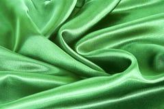 Fond vert de satin Photographie stock
