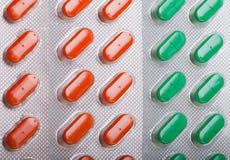 fond vert orange de pilules Photo stock
