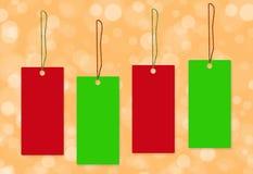 Fond vert rouge de bokeh d'étiquette Image libre de droits