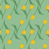 Fond vert sans couture avec les tulipes jaunes Photographie stock