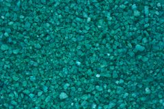 Fond vert, surface de texture de petit plan rapproché vert de cailloux image libre de droits