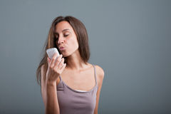 Fond woman sending kisses by phone Royalty Free Stock Photo