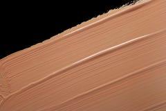 Fondamento liquido macchiato isolato sul nero Fotografie Stock