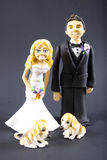 Fondant Bride and Groom with Dogs Wedding Topper Stock Image