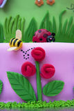 Fondant Cake. With flowers and ladybug stock photography