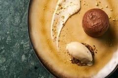 Fondant cake Dessert and pistachio ice cream with English cream. Pistachio crumble and sauce bailies royalty free stock image