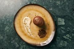 Fondant cake Dessert and pistachio ice cream with English cream. Pistachio crumble and sauce bailies stock photos
