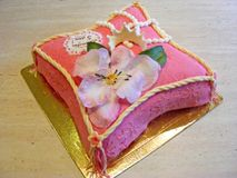 Fondant cake in form of pillow with flower for girl Stock Photo